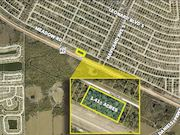 LEHIGH ACRES - RARE LARGER SIZED PARCEL WITH 350 FT. FRONTAGE ON SR-82